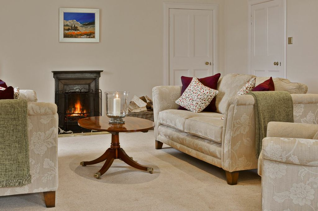 Relax in front of an open fire at Glencoe House