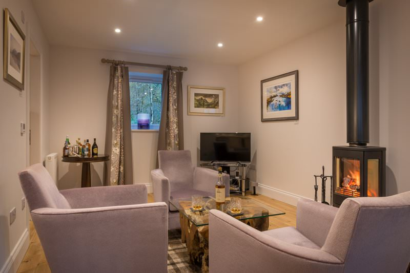 Relax in front of an open fire at the Bell Tower Suite Nine of Glencoe House